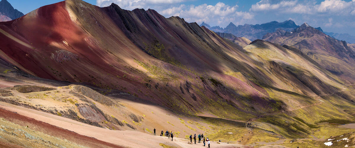 people-walking-along-rainbow-mountain