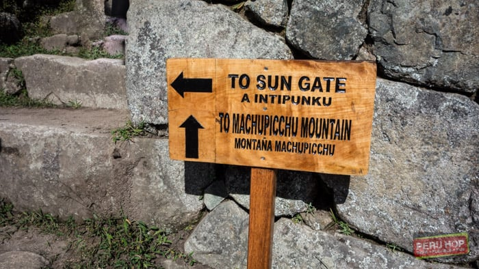 Machu Picchu Mountain - Sign showing directions to machu picchu mountain and the sun gate