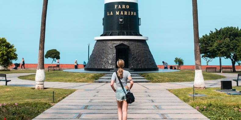 woman walking to the lighthouse traveling peru alone
