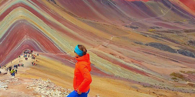 woman visiting rainbow mountain alone