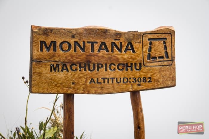 Machu Picchu Mountain - Sign showing machu picchu mountain and altitude