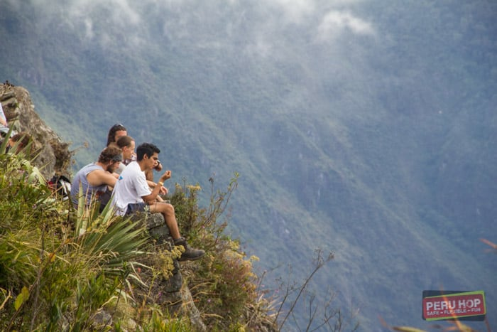 Machu Picchu Mountain - People sitting at machu picchu mountain