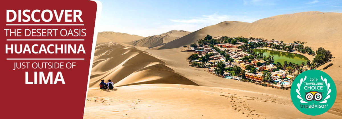 Couple of backpackers looking at Huacachina desert oasis in Peru