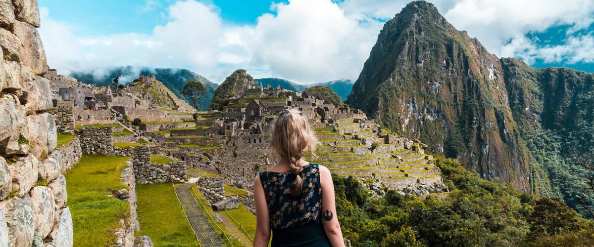 Blonde girl looking at Machu Picchu