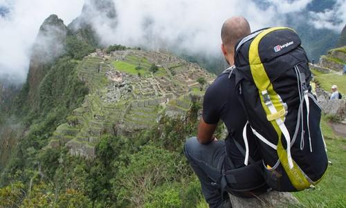 Budget Backpacking Peru – Man looking at Machu Picchu
