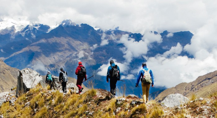 a group of backpackers on the top of a mountain on the Salkantay trek