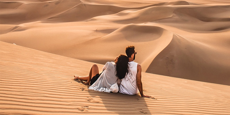 couple enjoying the sand in huacachina