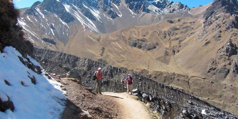 Trekkers staring back at camera on a portion of the Salkantay trek in Peru
