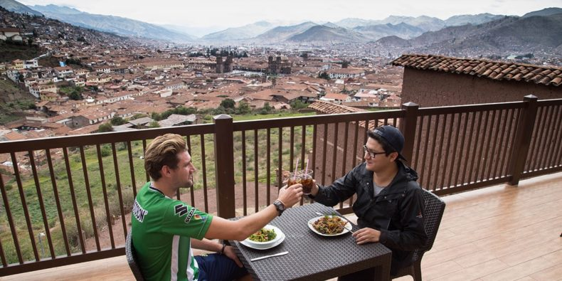 two friends enjoying breakfast in cusco accommodation